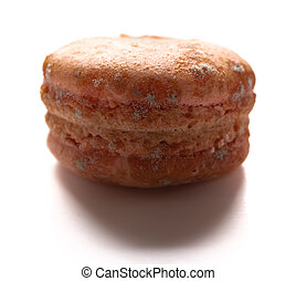 side view brown moldy macaroon on a white background