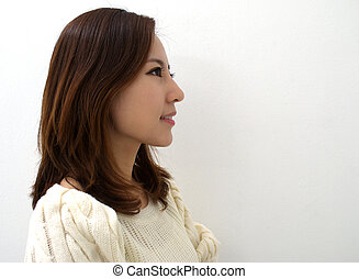Side view, close-up, beauty shot of a smiling
