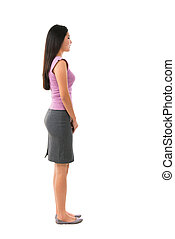 Side view full body of Asian female in office attire standing over white background