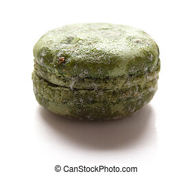 side view green moldy macaroon on a white background