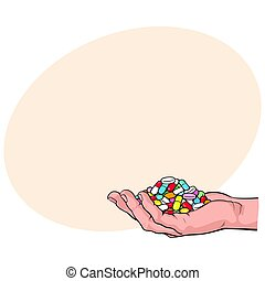 Side view hand holding pile, handful of pills, tablets, medicine