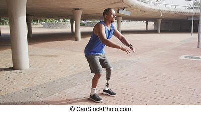 Side view man with prosthetic leg doing squats - Side view ...