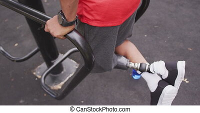 Side view man with prosthetic leg exercising - Side view ...