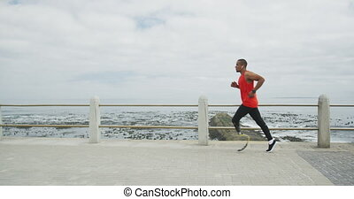 Side view man with prosthetic leg running - Side view of a ...