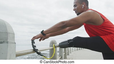 Side view man with prosthetic leg stretching - Side view ...