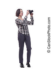 mature woman looking through the camera lens.