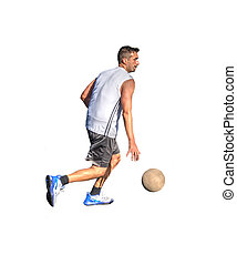 Side view of a basketball player dribbling on white