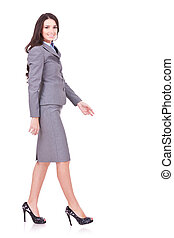 side view of a business woman walking