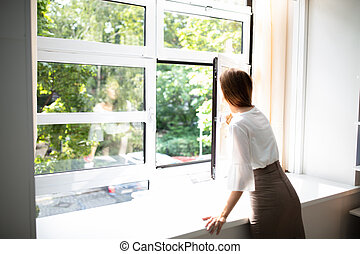 Businesswoman Looking Out Of A Window