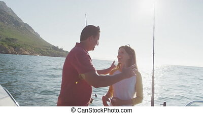 Side view of a Caucasian man and his teenage daughter ...