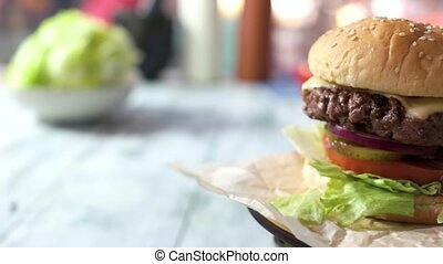 Side view of a cheeseburger.