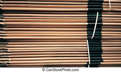 Side view of a corrugated cardboard pile in a factory - Side...