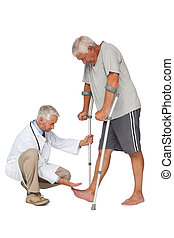Side view of a doctor with senior man using walker over...