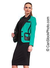 elegant business woman pulling her jacket