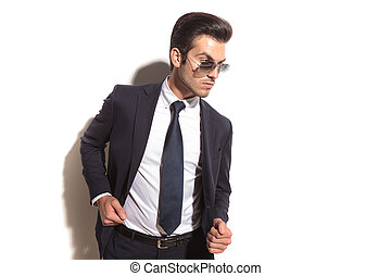 side view of a fashion business man posing