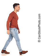 side view of a fit casual man walking