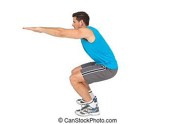 Side view of a fit young man doing stretching exercise