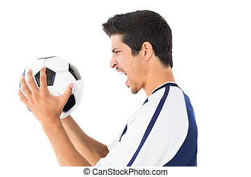 Side view of a football player shouting