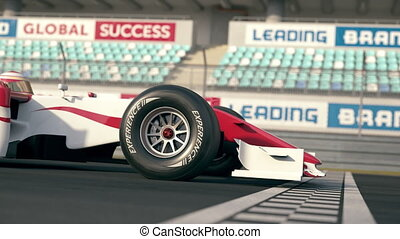 Side view of a formula one race car driving over finish line...