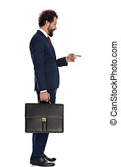 handsome businessman pointing to the side