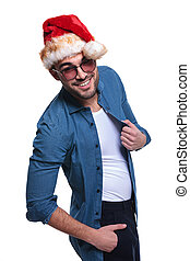 side view of a happy young man in santa hat