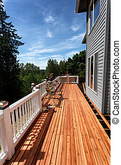 Side view of a home outdoor wooden deck being completely remodeled during springtime season