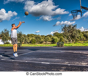 Side view of a lefty basketball player jump shot