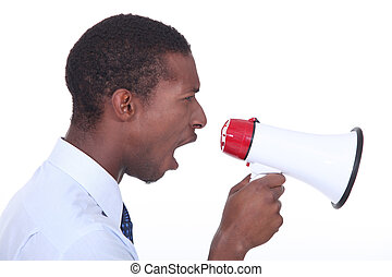 Side view of a man shouting into a megaphone
