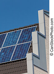 Side view of a newly build house with solar panels on the...