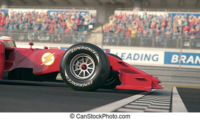 Side view of a red formula one race car driving over finish ...