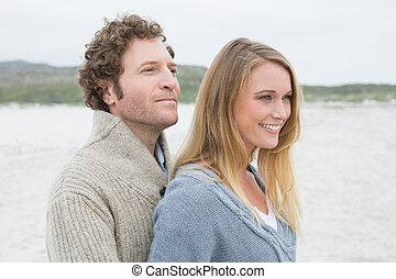 Side view of a relaxed young couple at beach