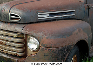 side view of a rusted out vintage pick up truck