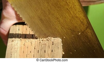 Side view of a saw cuting through 2x4 lumber