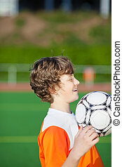 young boy practicing soccer