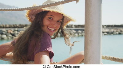 Side view of a teenage Caucasian girl harbor side - Side ...