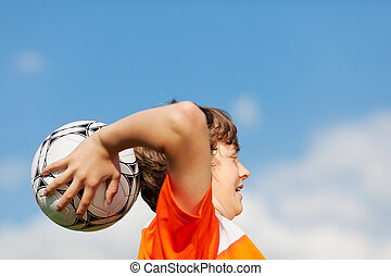 teenage soccer player throwing in