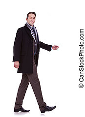 side view of a walking business man