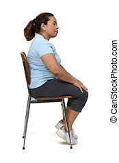 side view of a  woman sitting on a chair look side on white background