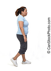 side view of a woman with sportswear walking on white background,