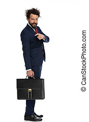 young businessman pointing at the camera with a serious look