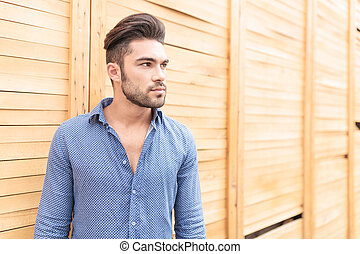 side view of a young casual man looking away
