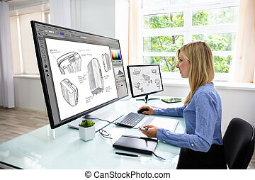 Designer Using Graphic Tablet While Working On Computer