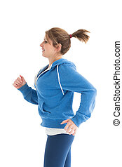 Side view of a young woman running