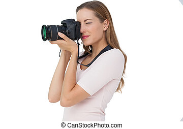 Side view of a young woman with camera