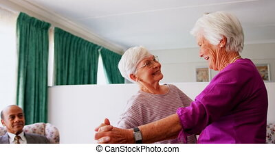 Side view of active Caucasian female senior women dancing together at nursing home 4k
