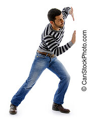 side view of active male dancing on an isolated white background