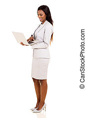 african business executive using laptop