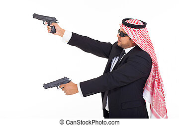 side view of arabic bodyguard holding guns on white...
