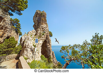 Side view of Arco Naturale, natural arch on coast of Capri island, Italy