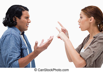 Side view of arguing couple against a white background